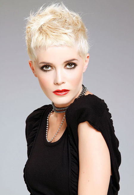 Very short blonde haircut with long lashes and smokey eye shadow for more intense looks with elegance.