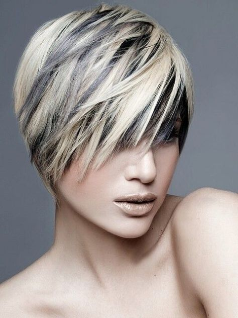 Short hairstyle with longer layers styled over the eyes and textured hair that covers the ears.