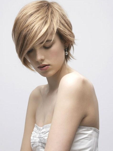 Short hairstyle with dominant bangs and long textured side burns which helps your long neck look more sexier.