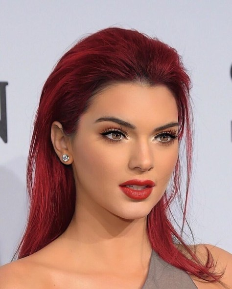 Medium long slicked back haircut for red hairs.