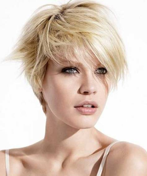 Short razor-cut hairstyle with a side parting