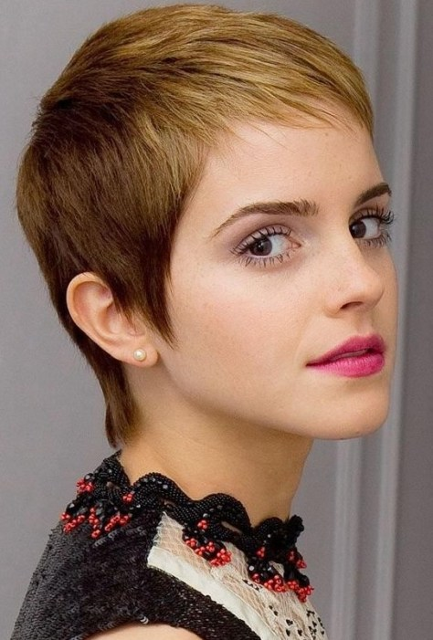 Girl with low maintenance short buzzed hair and little spikes into the face.