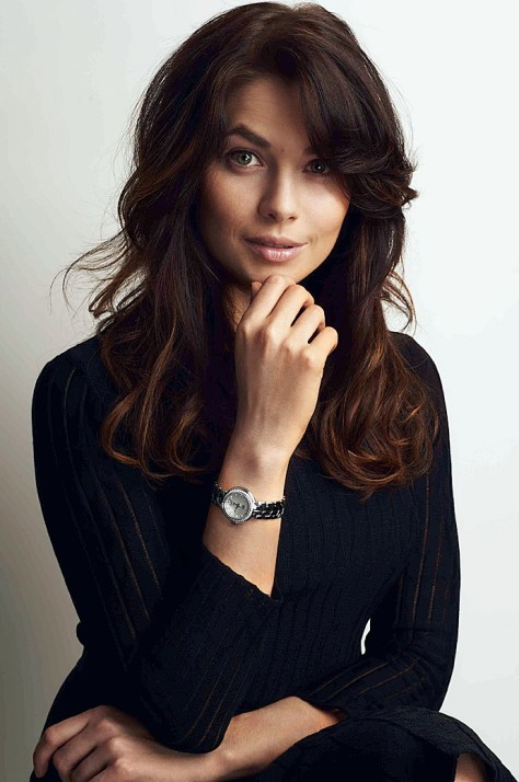 Youthful hairstyle, parted high on the crown and with an asymmetric fringe