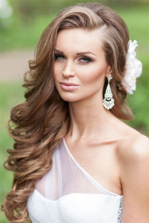 Long hairstyle with brown hair color over one side of the face