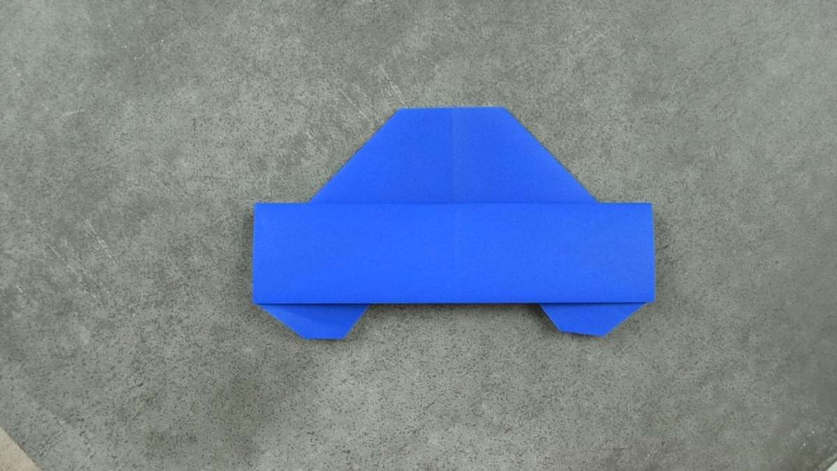 Blue Paper Origami Car On Gray Background Folded For FaveMom