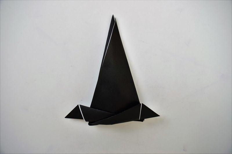black paper hat on white background