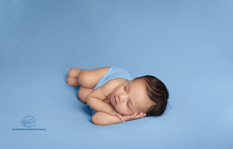 brisbane newborn baby photographed on a side pose