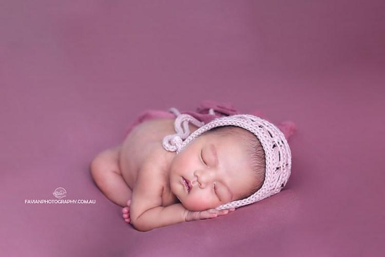 Brisbane newborn baby girl photographed on womb pose