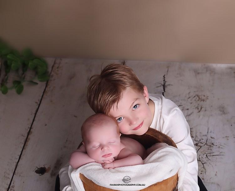 newborn and sibling pose