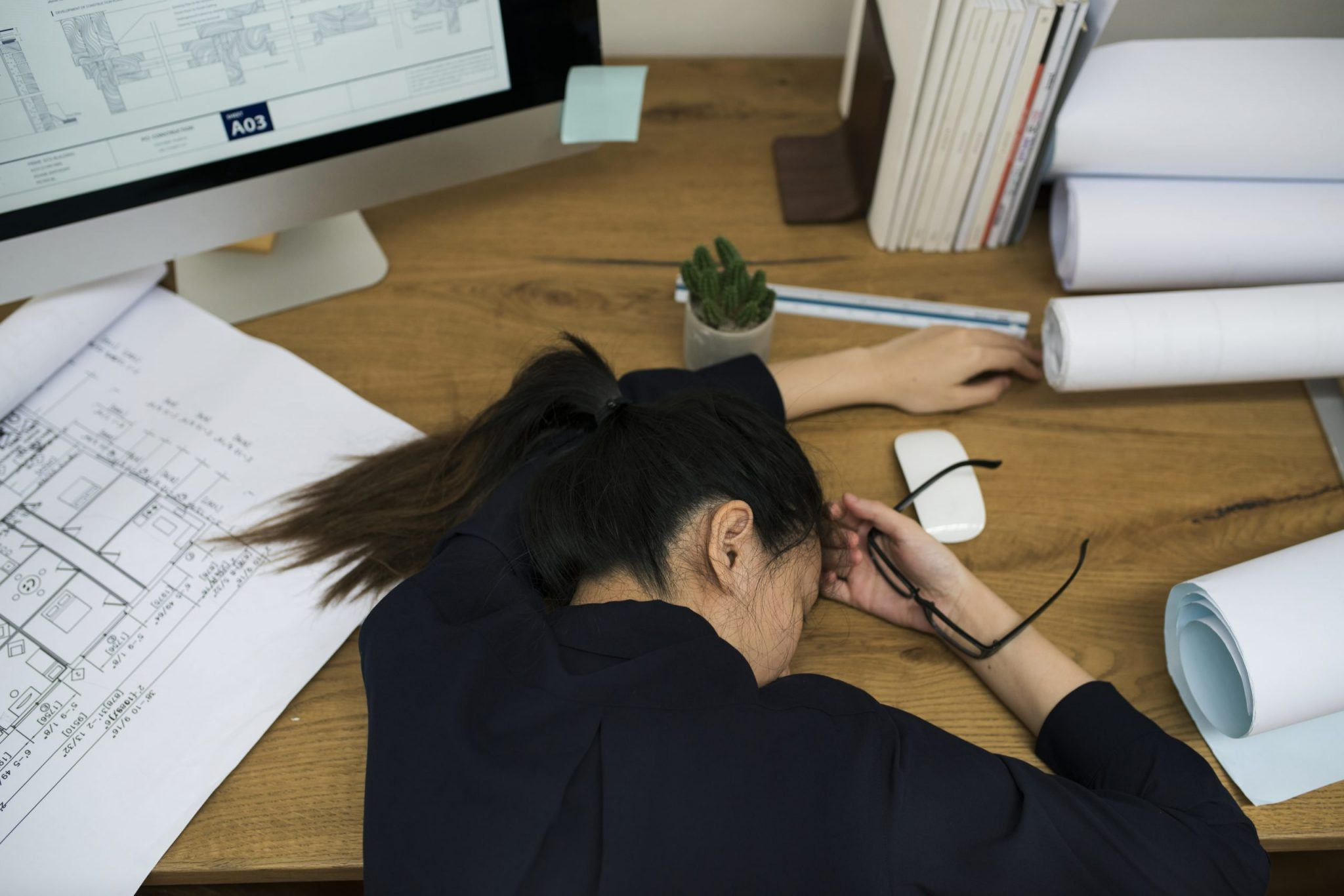 Businesswoman stressed and tired sleeping at the desk