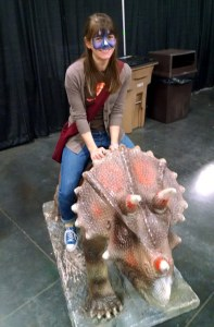 Coble rides a dinosaur last year at Discover the Dinosaurs at the Knoxville Convention Center.