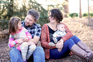 Jon Hathaway and his wife, Amy, hold their children, Quinn (left) and Rhys (right).