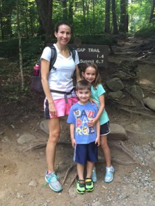 Odom and hiking in the mountains with her children, Emily, 7, and Andrew, 5.