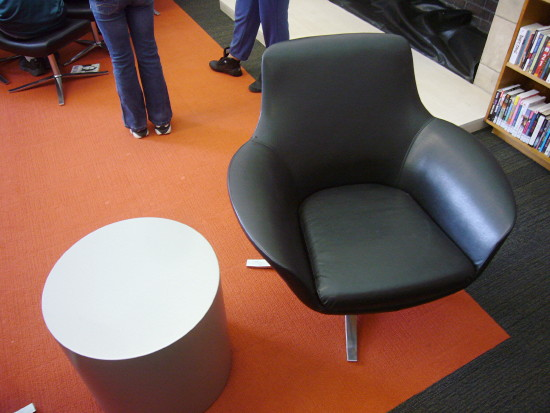 Black chair alongside round table