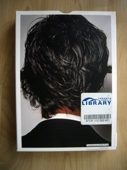 RFID tag stuck  boxed item to the right of the back of a man's head