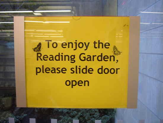 Sign on window: To enjoy the Reading Garden, please slide door open