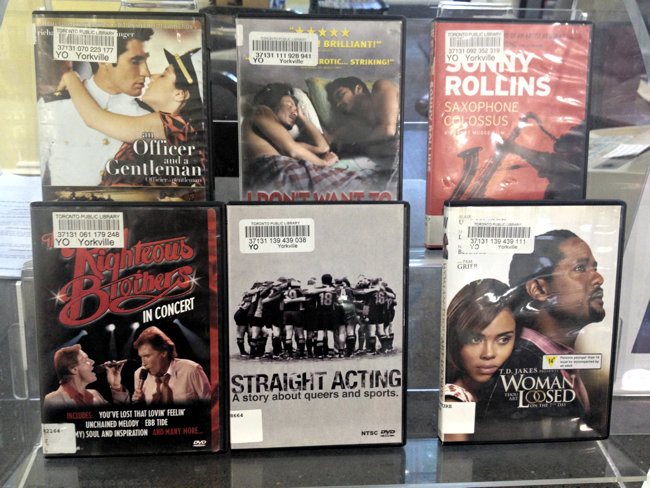 'Straight Acting' is one of six DVDs on a two-tiered display case