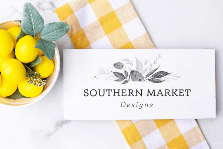 Wood sign mockup showing a wood sign design in a kitchen with lemons and a yellow checkered tea towel.