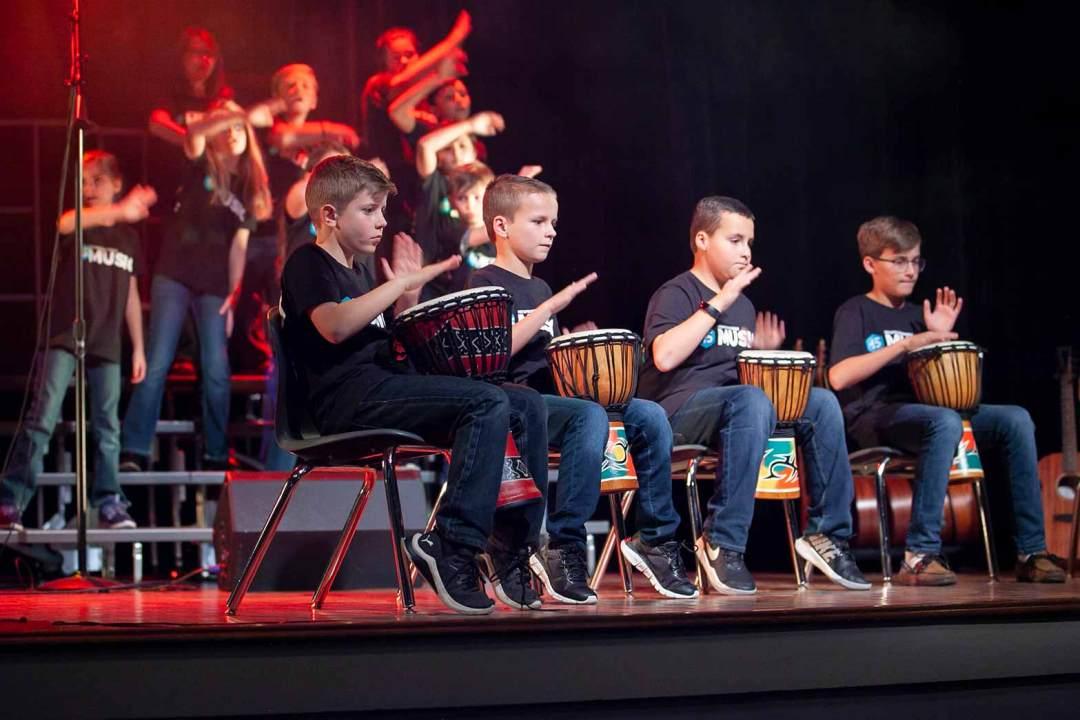 Boys playing drums during Night of Worship