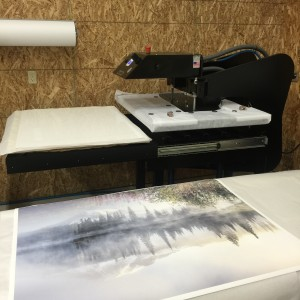 Our monster heat press (GeoKnight MaxiPress Air) with the special Endura polyester fabric around the heat platen to disperse steam
