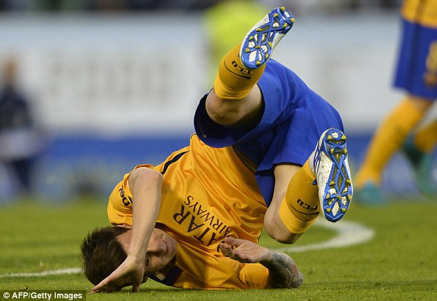 The Argentina star takes a tumble and lands on his head during his side's shock 4-1 defeat by Celta Vigo.
