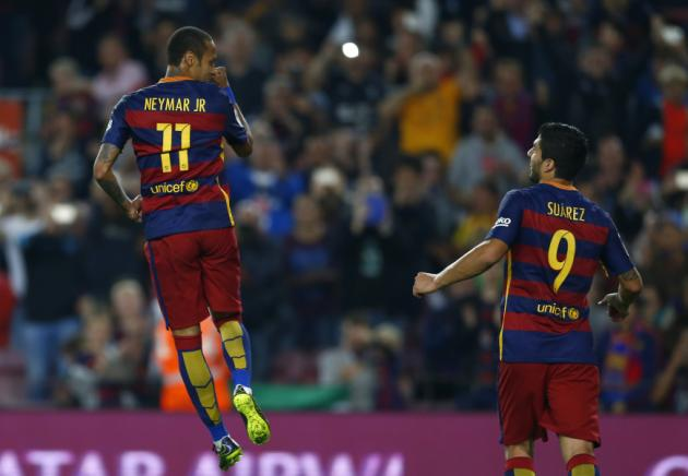 FC Barcelona's Neymar, from Brazil, left, celebrates after scoring against Rayo Vallecano during a Spanish La Liga soccer match at the Camp Nou stadium in Barcelona, Spain, Saturday, Oct. 17, 2015. (AP Photo/Manu Fernandez)