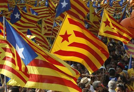 Marchers wave Catalonian nationalist flags as they demonstrate during Catalan National Day in Barcelona, September 11, 2012. REUTERS/Gustau Nacarino