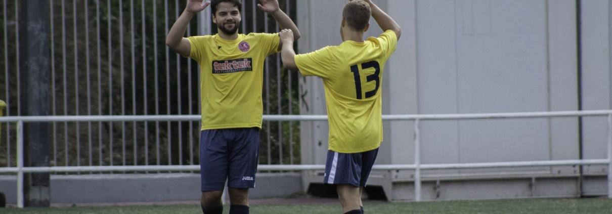FCB's Sean McBride & Sam Reid celebrate Sam's fine strike against Bar Hermanos Arribas