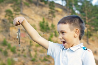 Fun boy with small fish