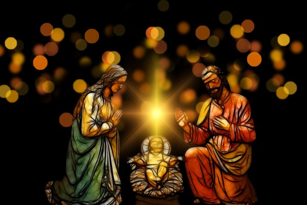 Mary and Joseph kneel on either side of a manger in which Jesus lays. A light hovers above Jesus, and individual golden orbs of light shine in the darkness behind the three figures.