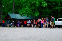 Students line up to get food under the shelter.