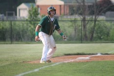 Senior Trey Fulton watches a foul ball before trying to steal home at the game on Friday, May 15.