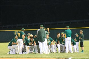 The varsity baseball team huddles after their HHC Tournament win against Columbus East on Friday, May 15.