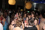 Participants at prom dance on the dance floor. Photo by Alaina King.
