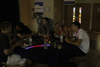 Seniors Sam Fulkerson, Clay Ables, Eric Lamm, Morgan Stanley, and Chase Blakeman talk and eat food at after prom. Photo by Alaina King.