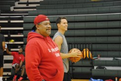 Peyton Siva Sr. laughs with former University of Louisville basketball star Kyle Kuric.