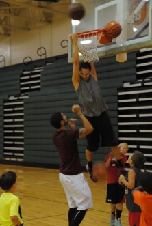 Kuric dunks as Siva and campers watch.