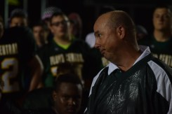 Head football coach Brian Glesing speaks to the team after their 35-20 win over Seymour.