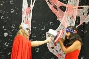 Junior Emma Pappas, who is dressed as Thor, pretends to strike junior Samanta Garcia who is dressed as Captain America.