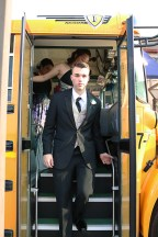 Senior Paden Pikey departs a school buss he and other FC prom participants rode to Kye's. Photo by Rebeca Flores.