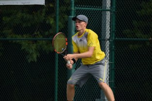Senior Joseph Naville prepares himself to hit the ball.