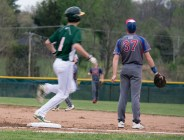 Sophomore Aaron Brown clears first base as Jenning County struggles to locate the ball.