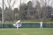 Senior Dalton Drexler throws to first.