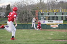 Junior Jarrett Agnew throws the ball to first for a double play.