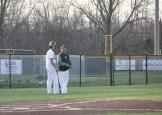 Junior Alex Lozado and head coach Casey LaDuke talk during Lozado's at-bat.