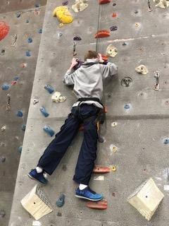 Brain injury survivor wall climbing