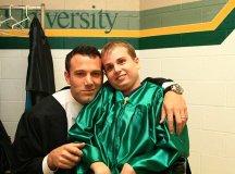 Falls Church High School graduate Joe Kindregam poses with friend Ben Affleck prior to Falls Church High's Graduation ceremony last Friday. Affleck was the keynote speaker. (photo: Paul Price)