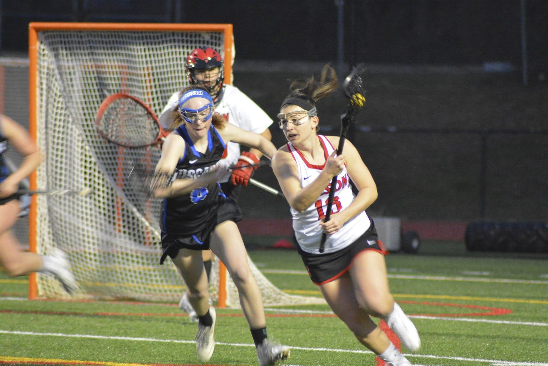 Mason senior Sarah Lubnow drives to the goal against Loudoun County High School on Tuesday. (Photo: Carol Sly)