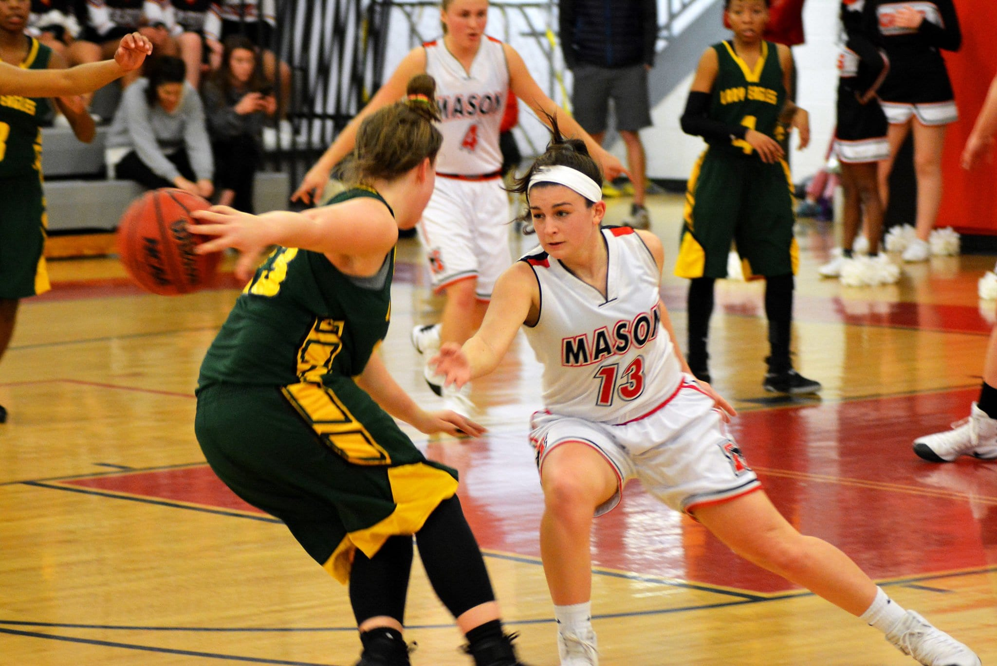 Sarah Lubnow plays defense during the Mustangs' 51-37 win over the Greensville County High School Eagles in the 2A East Region tournament. (Photos: Carol Sly)