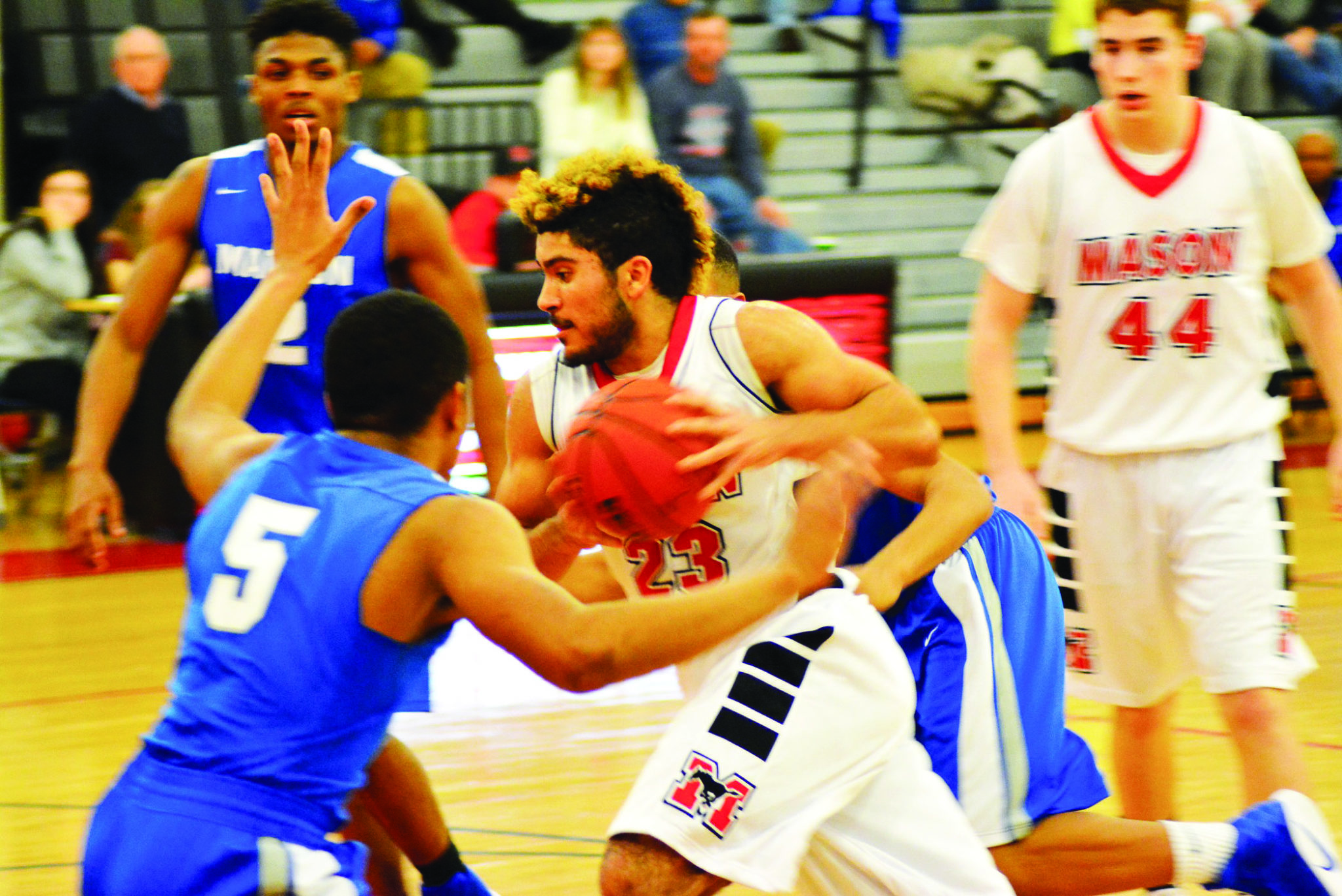 MASON'S Dustin Green drives to the basket in the Mustangs' 51-47 win over Madison. (Photo: Carol Sly)